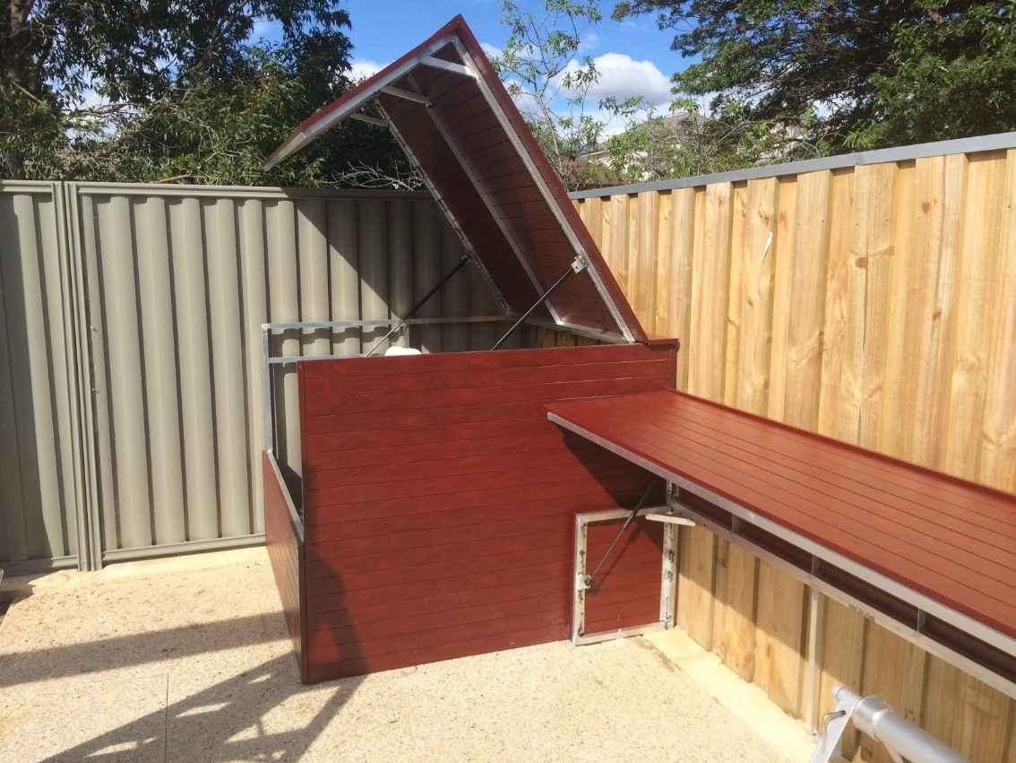 Brown wood filter pump pool box installation.